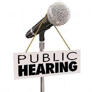 microphone with public hearing sign hanging from it